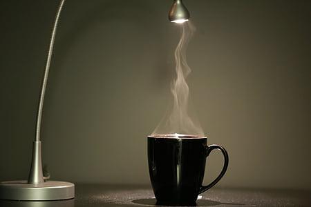 black mug near grey table lamp