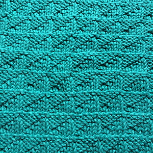 close-up photography of green knit textile