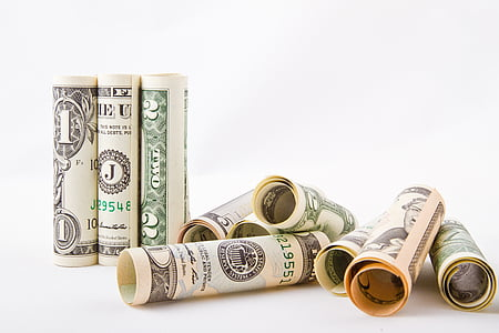 rolled U.S. dollar banknotes