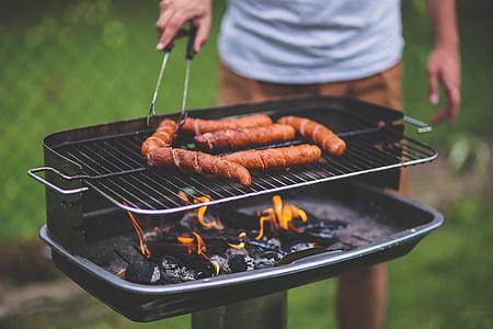 people grilling sausage