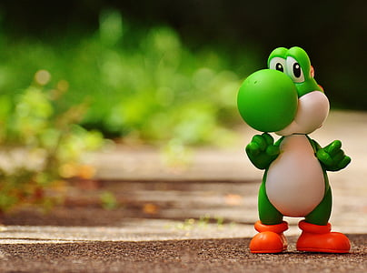 shallow focus photography of Yoshi model figure