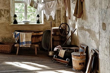 brown wooden barrel in the corner of a room