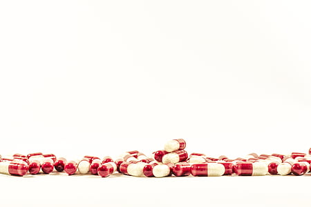 medication pill lot on white surface