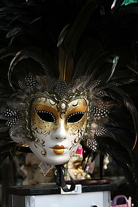 selective focus of white and gold masquerade