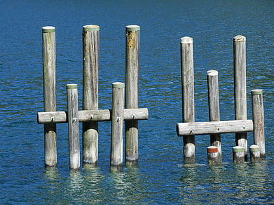 gray wooden pole on watr
