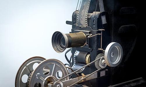 photo of vintage black camera with film