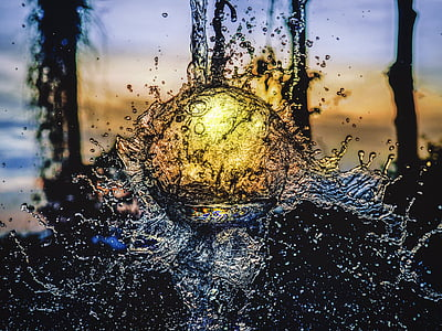 water splash during sunset