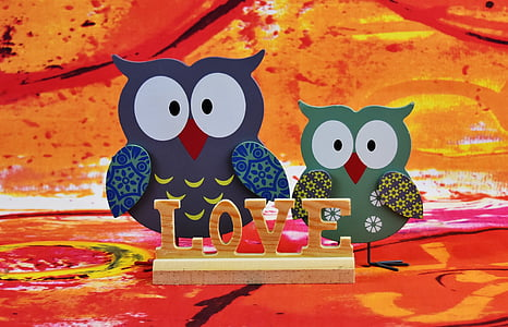 two owl cutout decors and freestanding letter