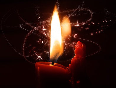 macro photography of lighted candle