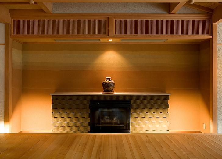 brown jar on fireplace