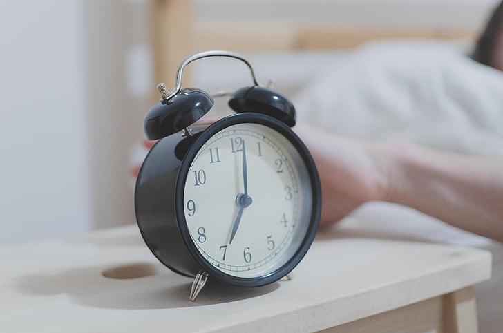 Royalty-Free photo: Analog alarm clock at 7:01 | PickPik