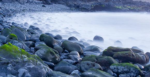gray coastal rocks during daytime