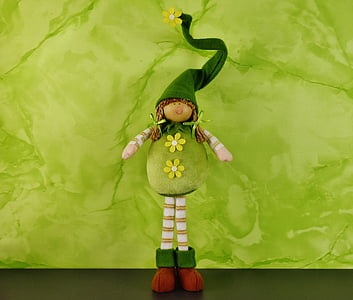 green and brown doll