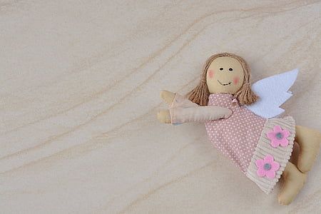 brown and white angel plush toy