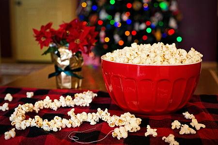 bowl of popcorn selective focus photograph