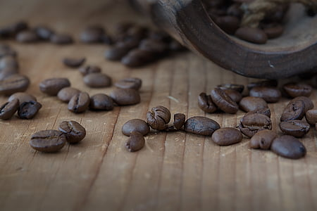 coffee beans on wood surface