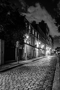 grayscale photography of street and buildings