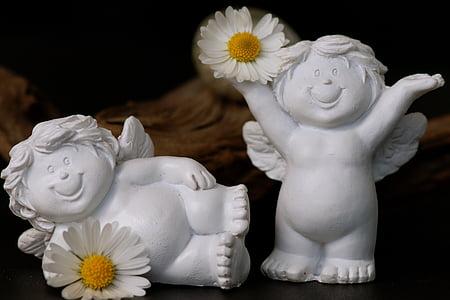 two white cherub figurines