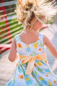 girl wearing multicolored dress