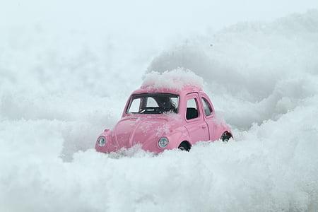 pink Volkswagen Beetle on snow land