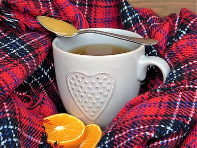 stainless steel spoon on top of white ceramic mug beside sliced orange fruit