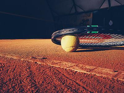black Wilson tennis racket on surface