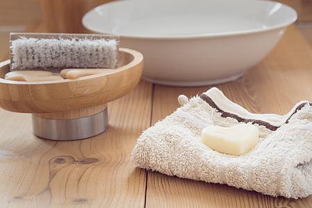 round white ceramic bowl beside brush