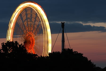 time lapse photography of Ferris wheel at night