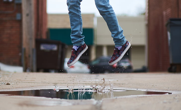 person over puddle of water