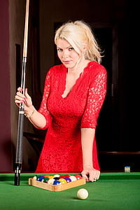 woman wearing red lace V-neck 3/4-sleeved dress holding cue stick