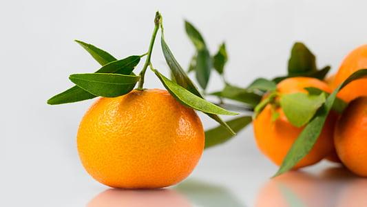 close up photo of orange fruit
