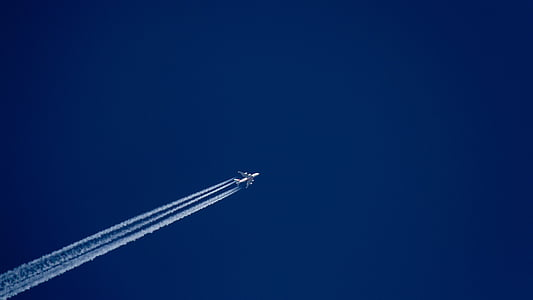 flying airplane in blue sky