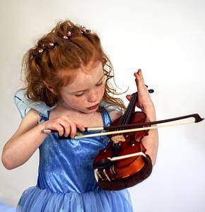 girl playing brown and black violin