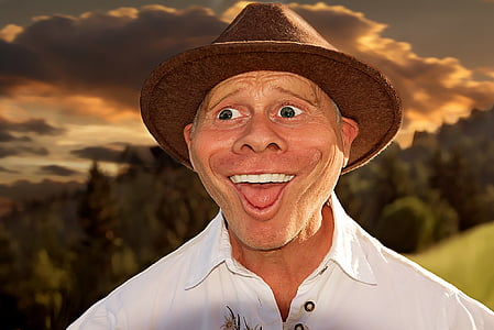 man wearing brown hat and white shirt