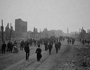 grayscale photo of people walking on roadway