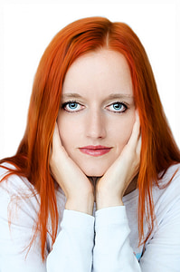 orange-haired woman in white long-sleeved shirt