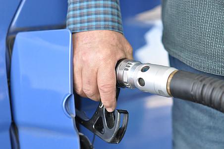 person holding gasoline nozzle