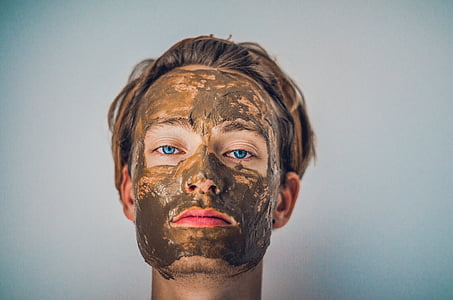woman's face with mud mask