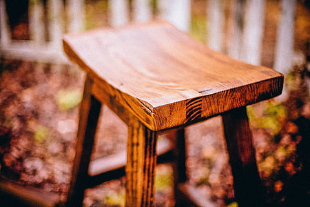 selective focus photography of brown bar stool