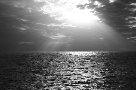 grayscale photography of body of water during daytime