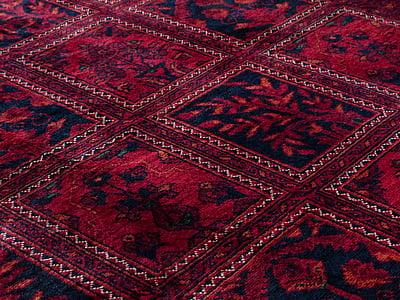 pink, blue, and orange floral area rug