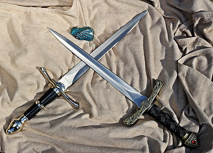 two silver swords with black handle