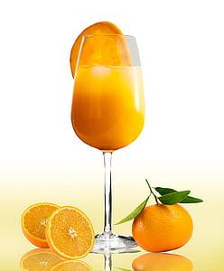 orange juice in clear goblet glass with orange slices