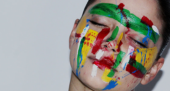 person with assorted-color face paint