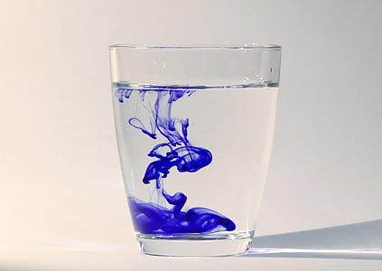 clear drinking glass with blue liquid