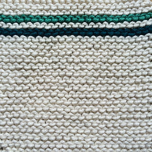 white and teal knit textile