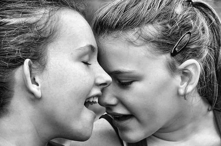 grayscale photo of two women face to face