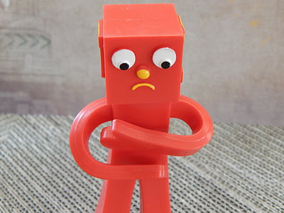 close-up photography of red toy robot