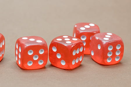 five red-and-white gaming dice on focus photo