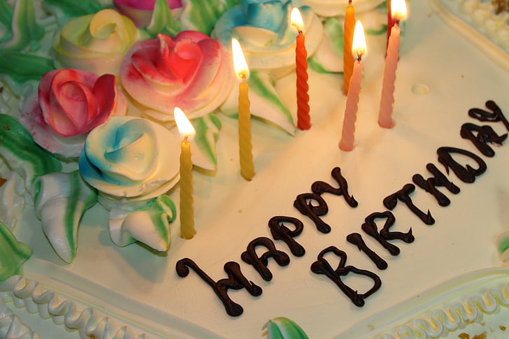 Happy Birthday Cake With Seven Lighted Candles
